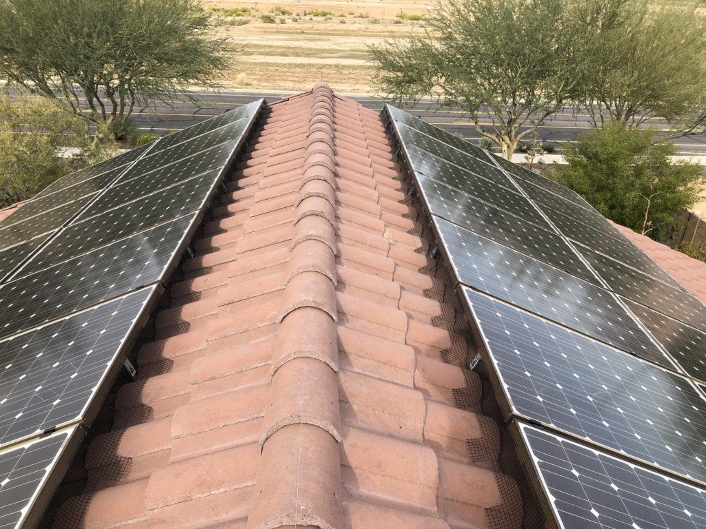 Pigeon abatement around the solar panels and birdwire installed across the peak by the Pigeonpros